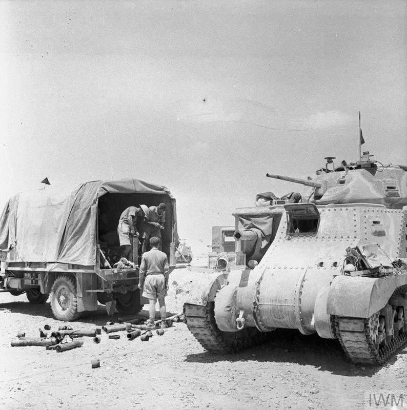 Grant tank crew loading up with ammunition from a truck, 18 June 1942. IWM photo E 13551