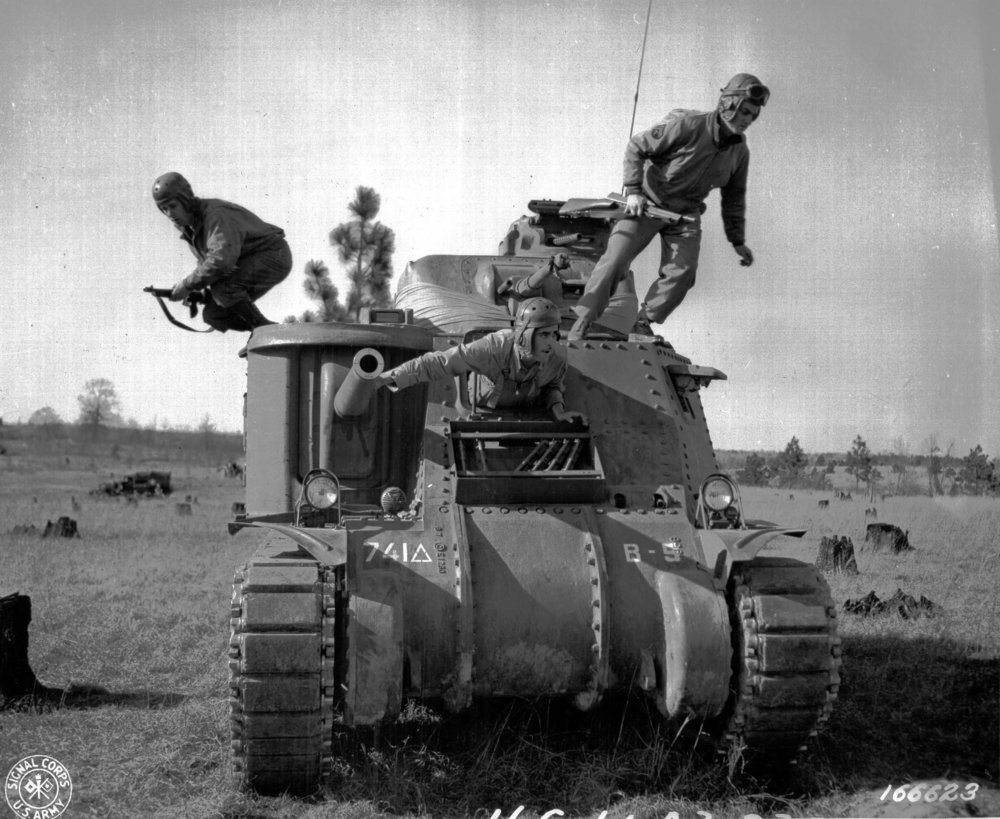 M3 crew practice abandoning their tank at Camp Polk, Louisiana. 12 Feb 1943. Co. B, 741st Tank Bn.
