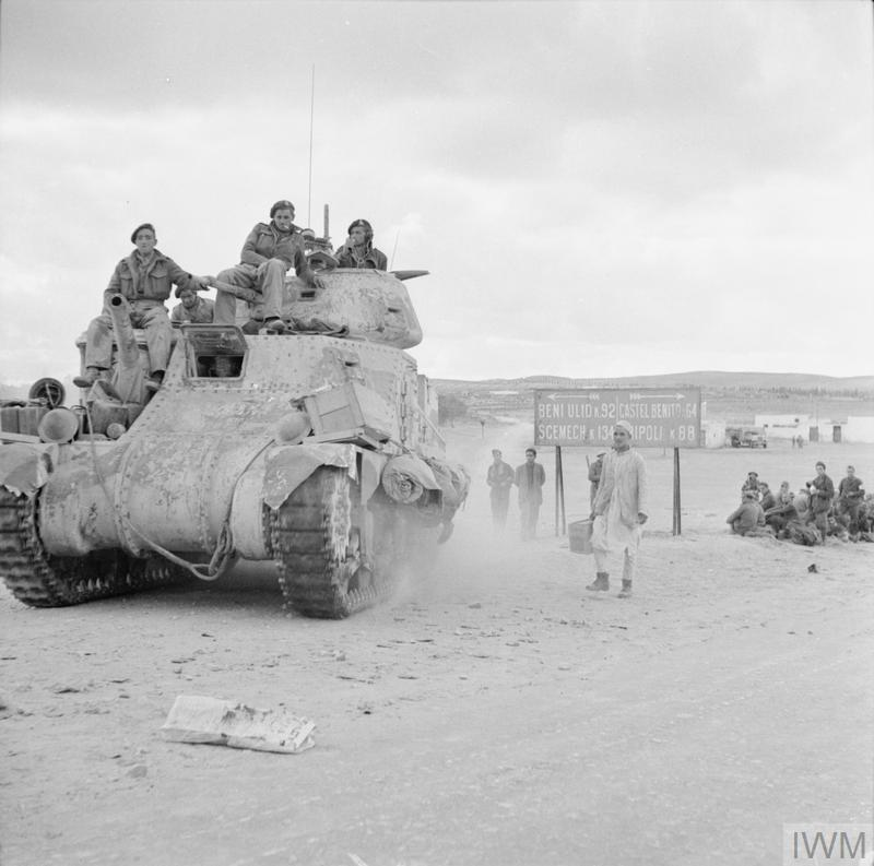 A Grant tank passing through Tarhuna on its way to Tripoli, 25 Jan 1943. IWM photo E 21568