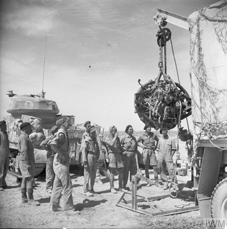 The engine of a Grant tank is removed for overhaul by the mechanics of a light recovery section of the Royal Army Ordnance Corps, 10 Jun 1942. IWM photo E 13233