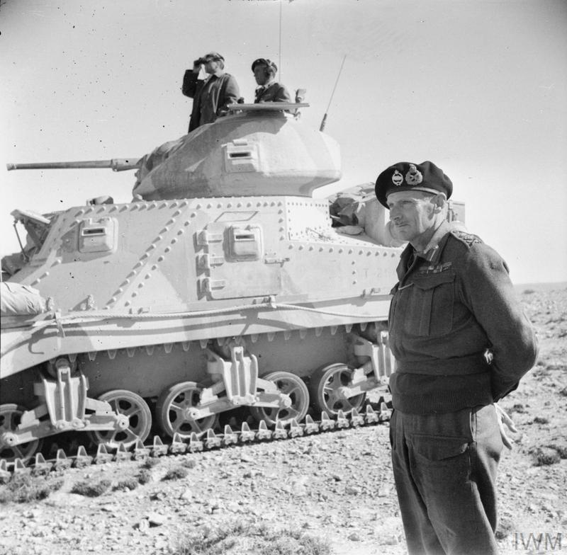 General Montgomery stands beside a Grant command tank near Tripoli, 27 Jan 1943. IWM photo E 21701