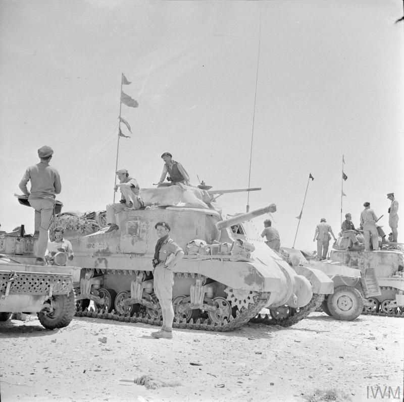 Grant tanks and scout cars of an armoured brigade headquarters in the Western Desert, 31 May 1942. IWM photo E 12637