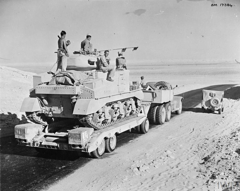 A Grant tank being taken to the forward areas on a Diamond T transporter, 13 Aug 1942. IWM photo E 15583