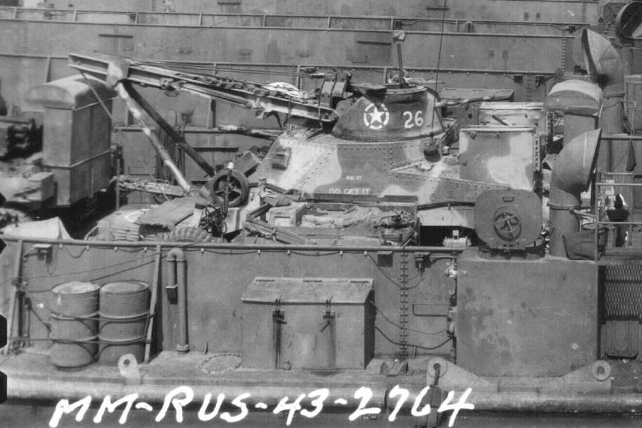 """GO GET IT'' M31 (  G Company, 66th Armored Regiment, 2nd Armored Division) outfitted with wading trunk aboard LCT for the Invasion of Sicily. Bizerte, Tunisia, 2 Jul 1943."