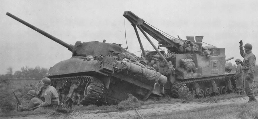 """GO GET IT'' recovers an early production M4A1 (76) that has slid into a ditch. Nieuwstadt, Netherlands, 29 Sep 1944."