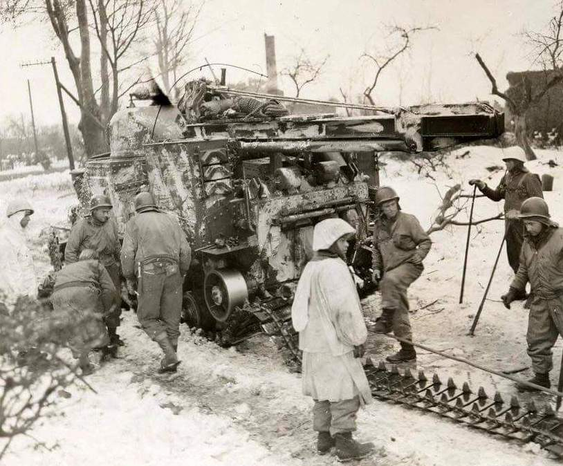 M31 (T2) track maintenance during the Battle of the Bulge.