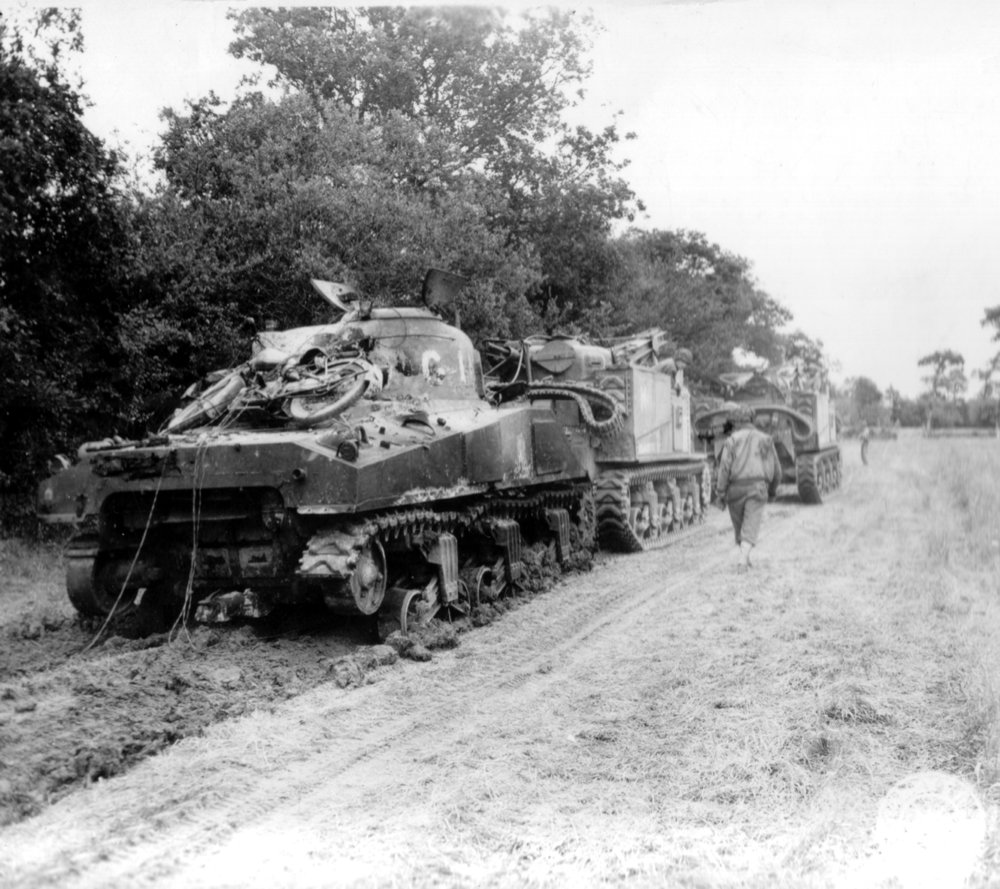M31 of the 3rd Armored Division recovering a M4. Saint Fromond (Normandy), France. 14 Jul 1944.