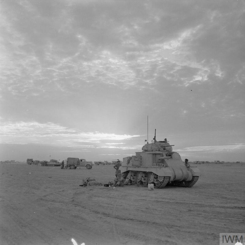 El Alamein 1942: British tanks wait to rejoin the battle at dusk. IWM photo E 18532
