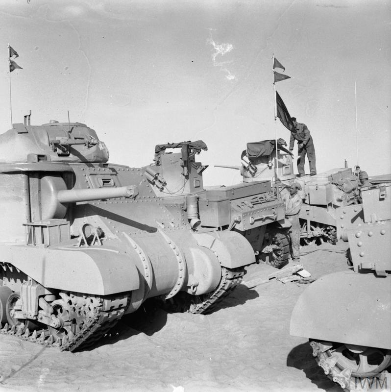 Newly-delivered Grant and Stuart tanks being spray painted shortly after their arrival in the Middle East, 29 Mar 1942. IWM photo E 9885