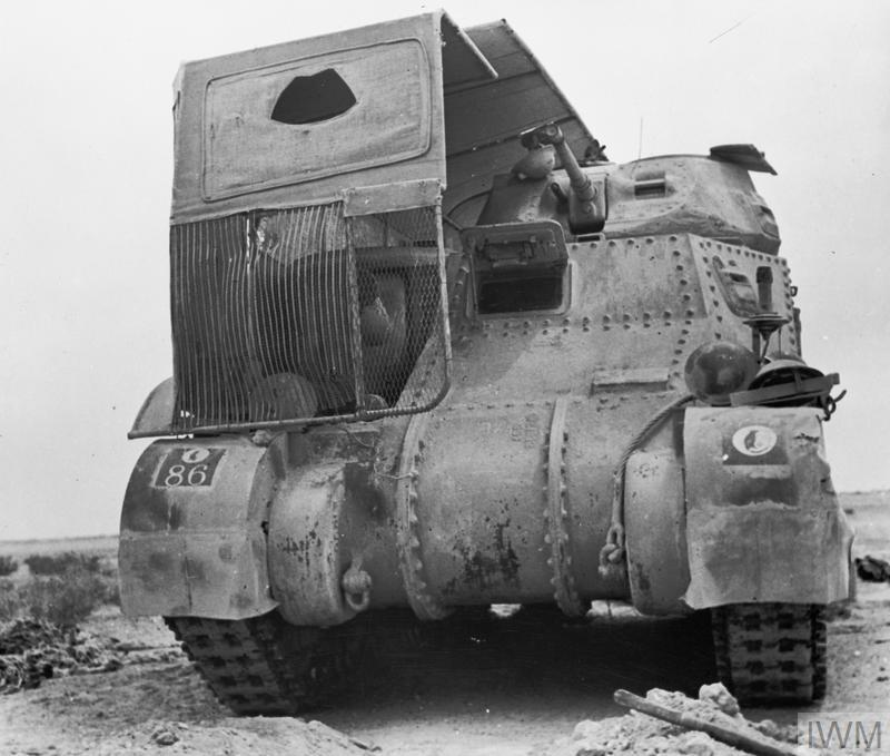 A Grant tank partially fitted with 'sun shield' lorry camouflage, Jun 1942. IWM photo E 13380
