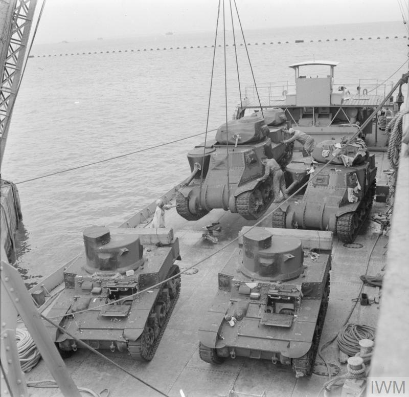 "New Grant and Stuart tanks being unloaded from a ship onto a ""Z"" craft which will then take them ashore, 13 March 1942. IWM photo E 9226"