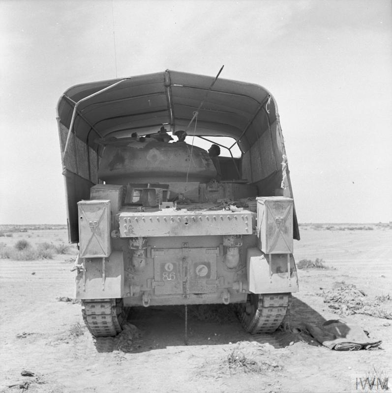 The rear view of a Grant tank fitted with 'sun shield' lorry camouflage, Jun 1942. IWM photo E 13379