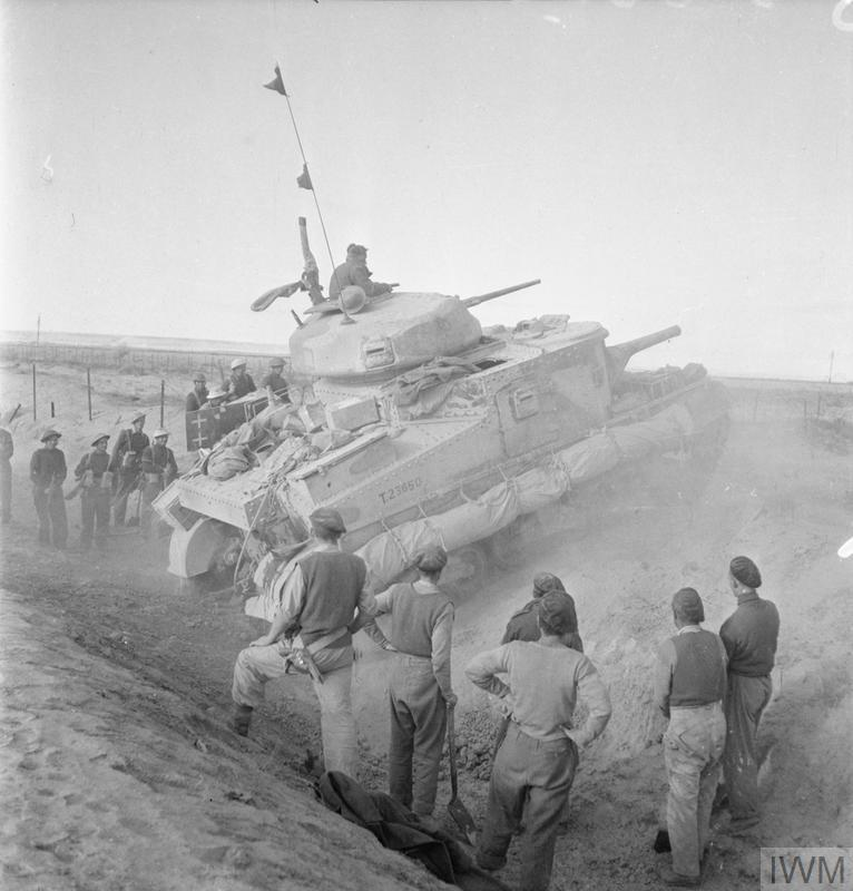 A Grant tank crossing a steep ditch outside Mersa Matruh, 11 Nov 1942. IWM photo E 19316