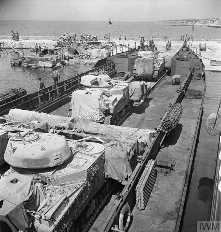 Grant tanks, including flail variants, embarking onto a landing craft at Tripoli, 3 Jul 1943. IWM photo NA 3989