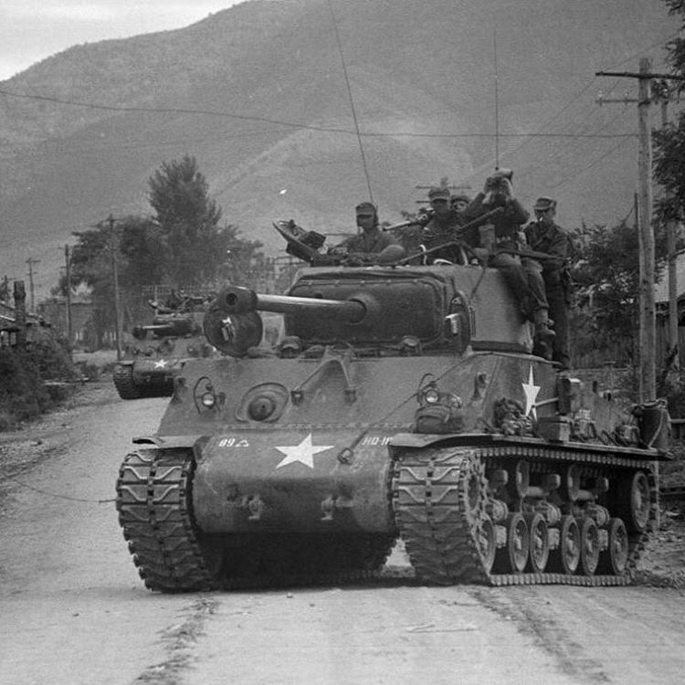 M4A3E8 Shermans of the 89th Tank Battalion advancing north through Seoul.