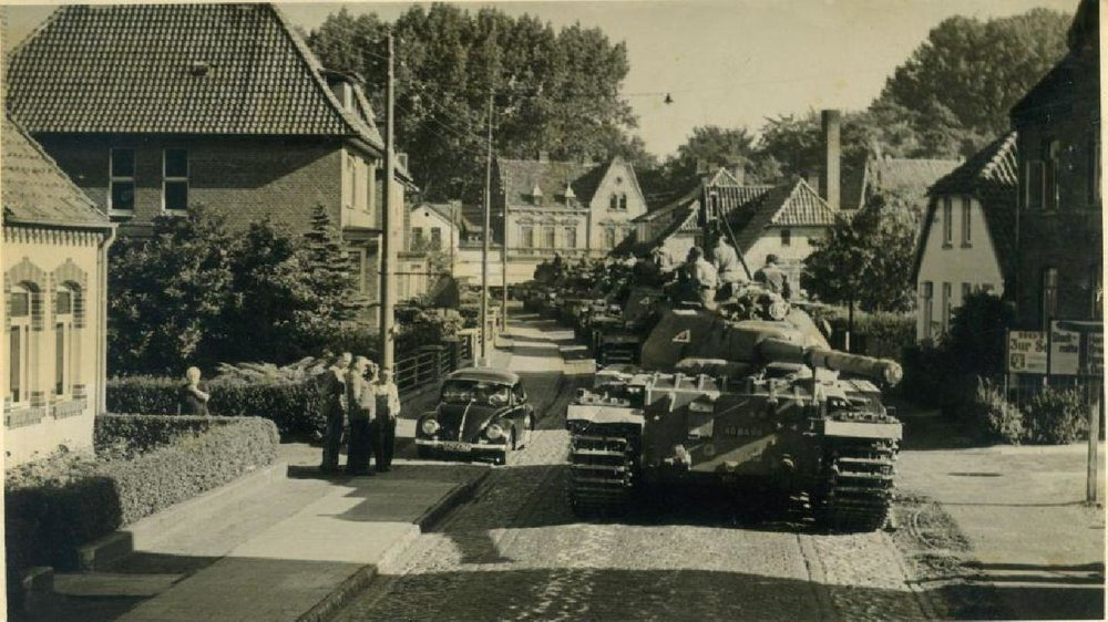 Conquerors passing through a German village.