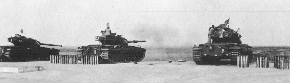 Conqueror Mk 2 tanks of 11th Hussars on a firing range in Germany.