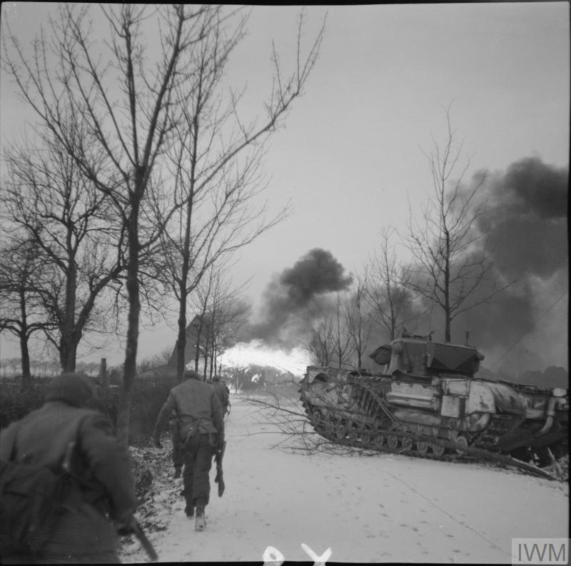 Churchill Crocodile flamethrowers in action against the village of St Joost, north of Schilberg, during an attack by 1st Rifle Brigade, 20 Jan 1945. IWM photo   B 13944.