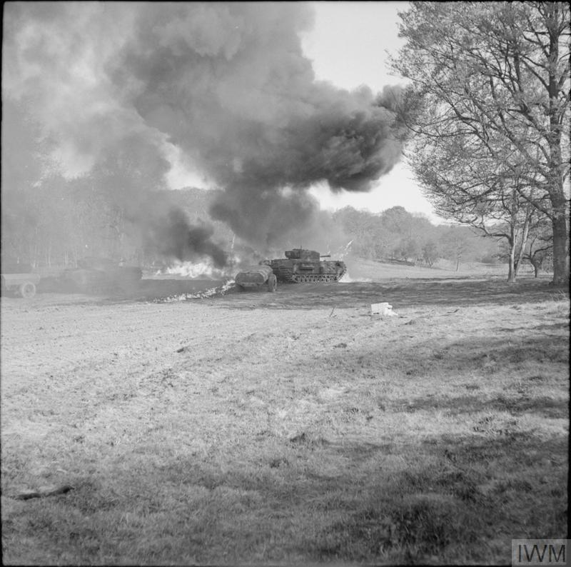 Churchill Crocodile flame-throwers in action during trials at Eastwell Park, Ashford, Kent, 26 Apr 1944. IWM photo H 37918.