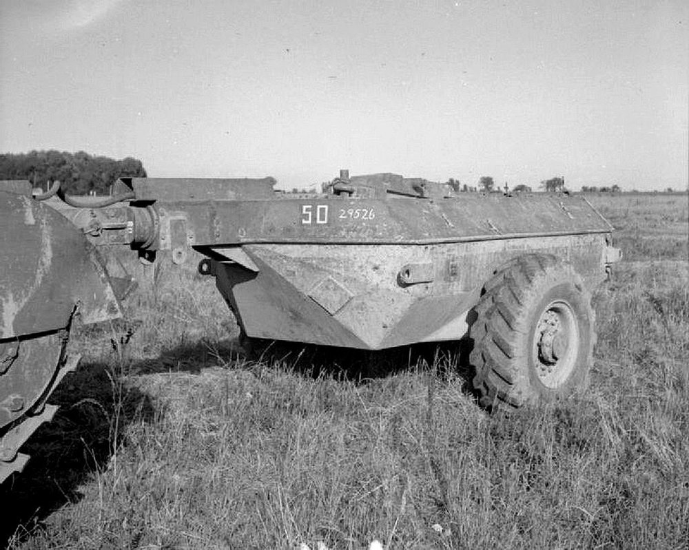 A Churchill Crocodile flame-throwing tank during a demonstration, 25 August 1944. Close-up of the fuel trailer.IWM photo B 9685.