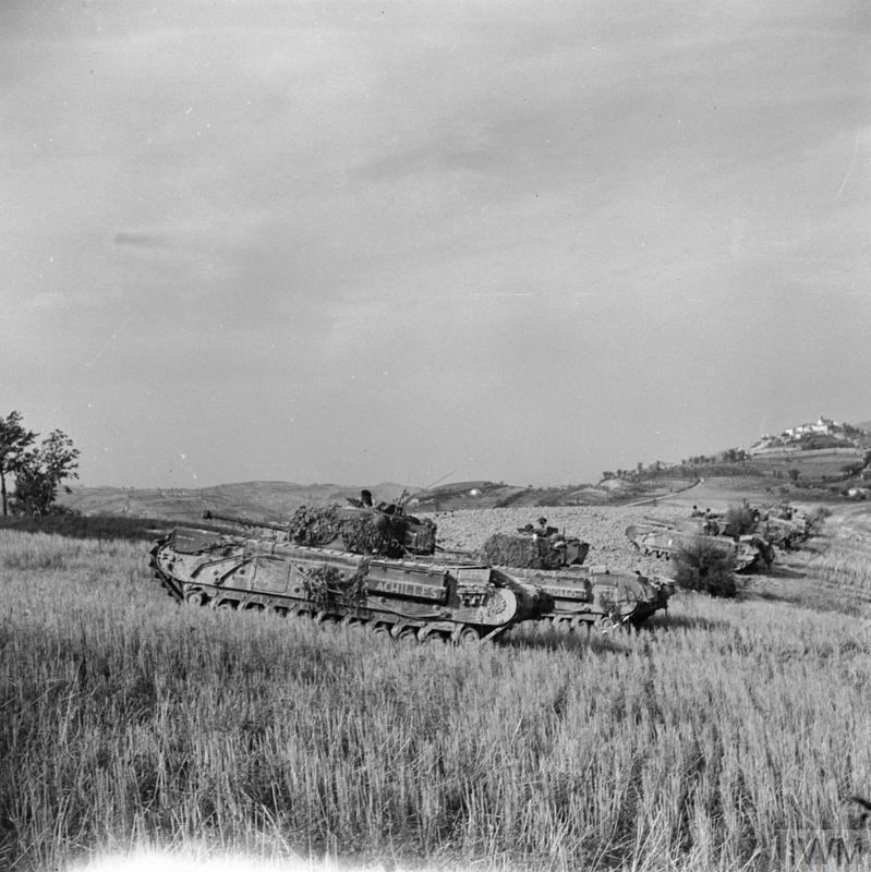 Churchill tanks of 51st Royal Tank Regiment near the River Foglia, 30 Aug 1944. The tanks were supporting infantry of 139th Brigade attacking across the river. IWM photo NA 18129.