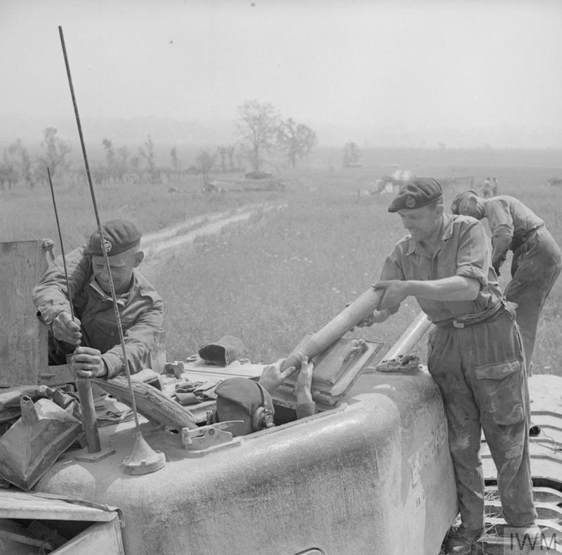 Ammunition being passed into the turret of a 25th Tank Brigade Churchill supporting the 1st Canadian Division, 17 May 1944. This was the first use of Churchills in Italy. IWM photo NA 14974.