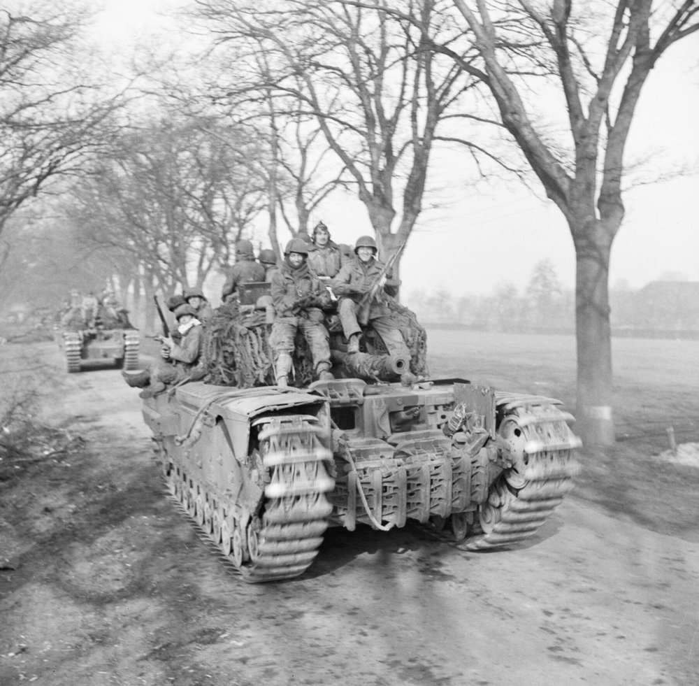6th Guards Tank Brigade Churchills carrying paratroopers of the 17th US Airborne Division, Germany, 29 Mar 1945. IWM photo BU 2737. Note the front soldiers with captured MP-44 assault rifles.