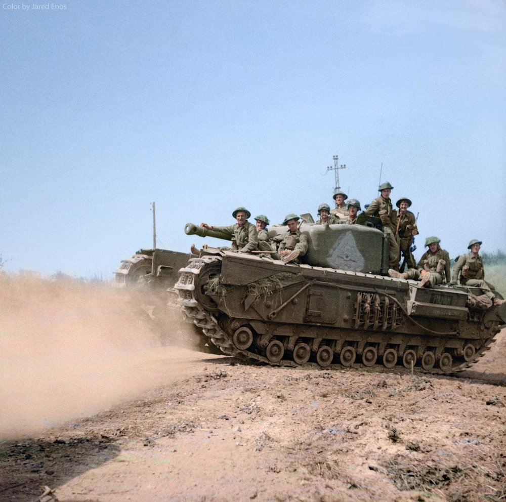 Churchill VI of the 4th Battalion, Grenadier Guards, 6th Guards Armoured Brigade, advancing towards St. Pierre Tarentaine, France, 1944.