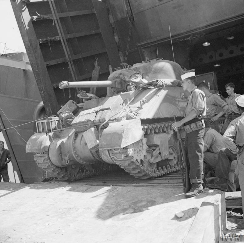 A Sherman tank of 40th Royal Tank Regiment reversing into a landing ship at Bizerta, 4-9 Sep 1943. IMW photo NA 6653.