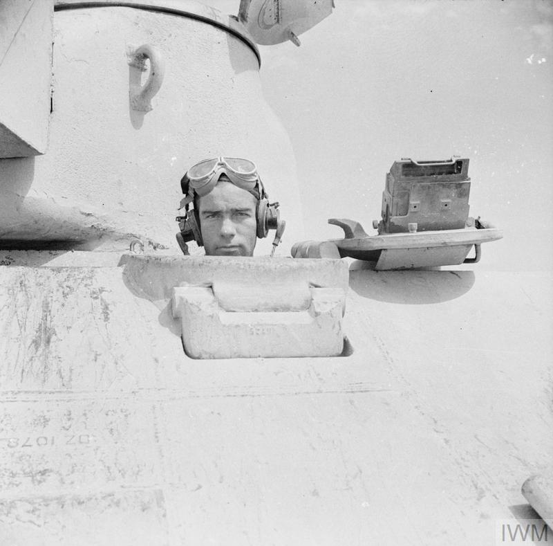 Close-up of the driver of a Sherman tank, 13 Oct 1942. IWM photo E 17966.