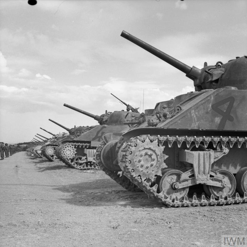 Sherman tanks on parade during a visit by the Turkish Military Mission, 28 Mar 1943. IWM photo NA 1574.