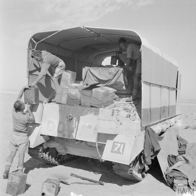A Sherman tank of HQ 24th Armoured Brigade, with its 'sunshield' lorry camouflage erected, 26 Oct 1942. IWM photo E 18463.