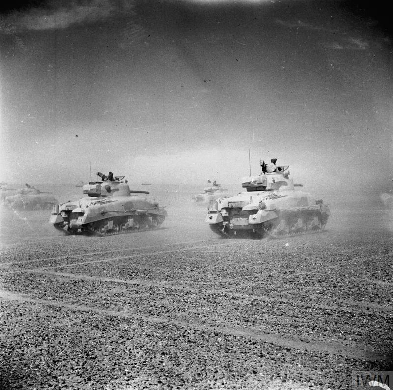 Sherman tanks of the Eighth Army move across the desert at speed as the Axis forces begin to retreat from El Alamein. IWM photo E 18971.