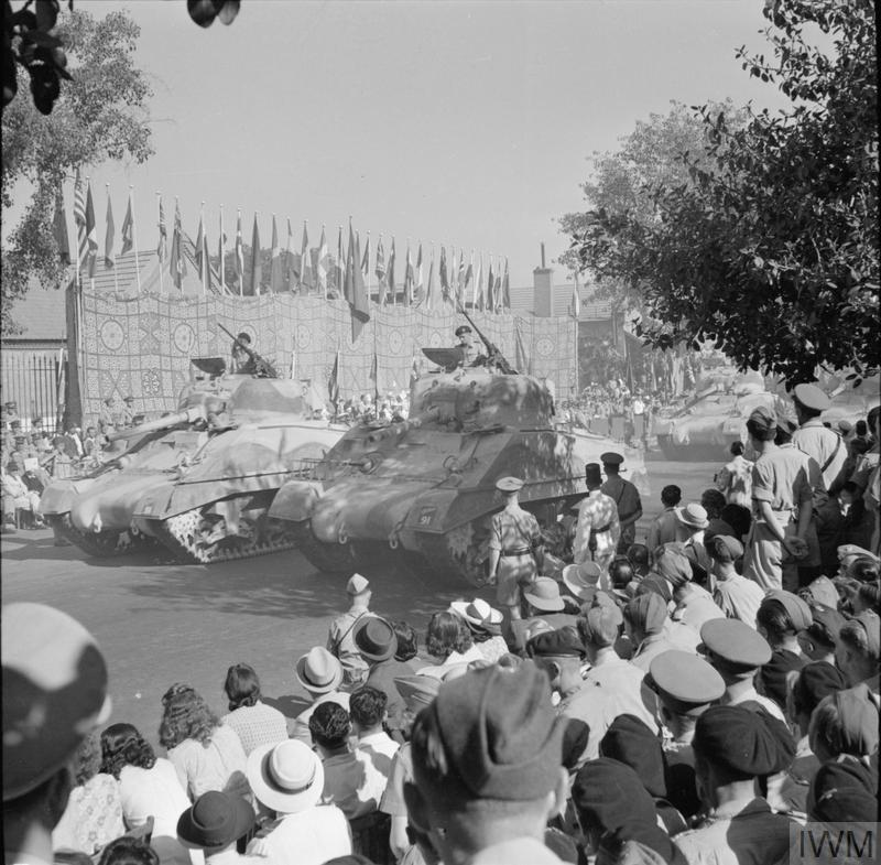 Two Sherman tanks taking part in the United Nations parade in Cairo which saw 5,000 troops and vehicles pass through the city, 14 Jun 1943. IWM photo E 25247.