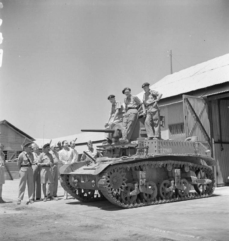 Men of the Royal Tank Regiment, training on the new American M3 Stuart tank, being inspected by Mr Walter Kirk, American Minister to Egypt, 17 Aug 1941. IWM photo E 3450E.