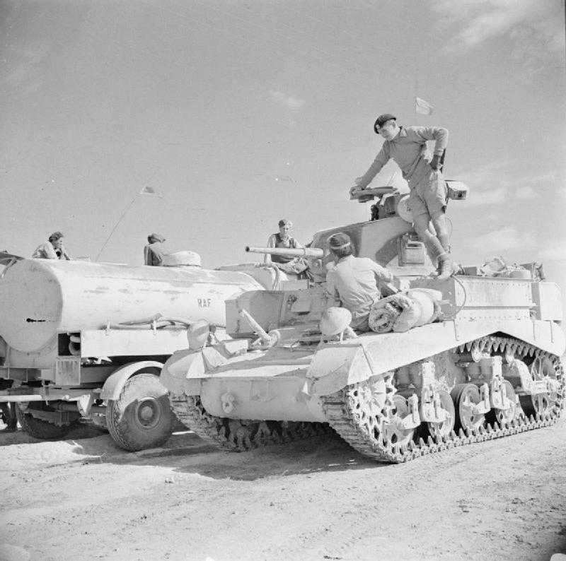 A Stuart tank being refuelled from an RAF fuel bowser outside Sidi Barrani, 15 Nov 1942. IWM photo E 19587.