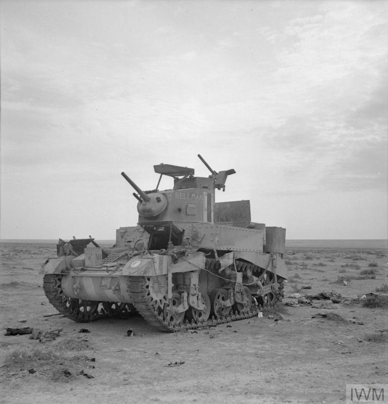 ''BELLMAN'', an M3 Stuart tank of 8th Hussars, 7th Armoured Division, knocked out near Tobruk, 15 Dec 1941. IWM photo E 7044.