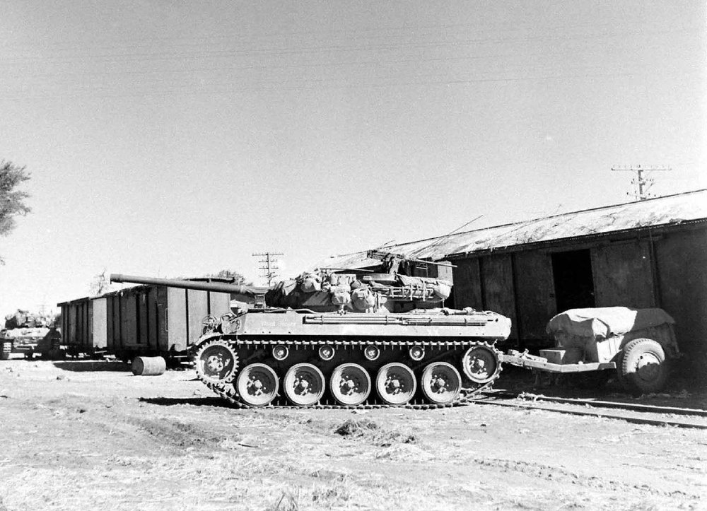 M18 Hellcat TD towing M10 ammo trailer.