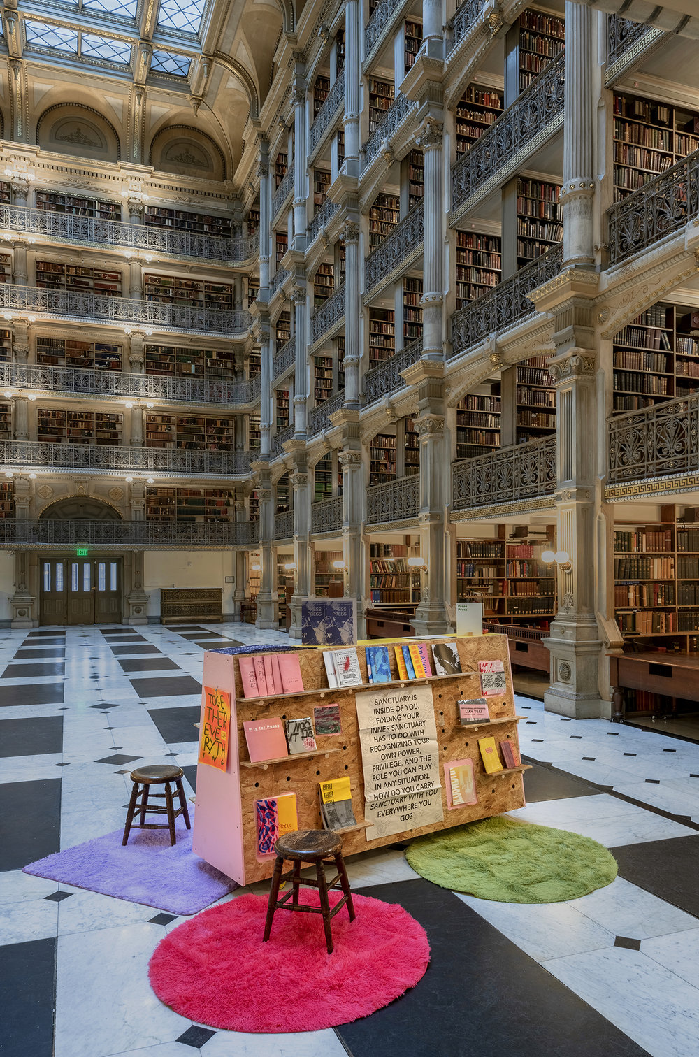 Interior of George Peabody Library with wooden mobile cart displaying Press Press publication archive