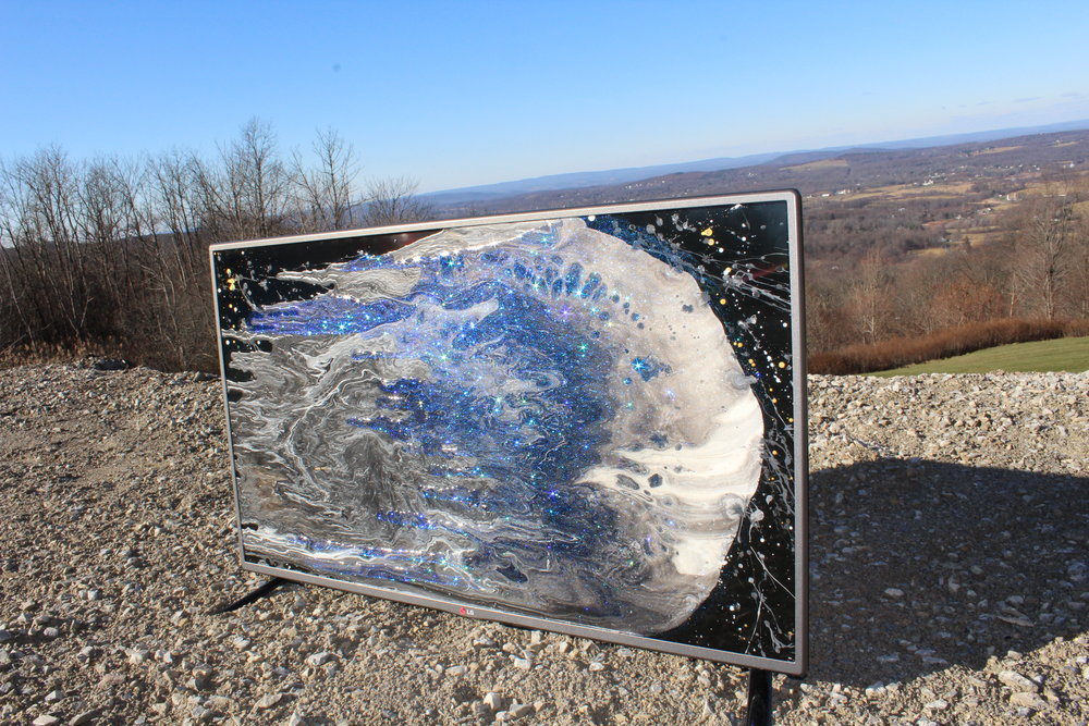 """Media Meteor"" Acrylic and Epoxy on T.V.   ""This piece is a representation of how the media comes crashing into homes all around the world like a meteor. Can you trust an object of destruction and propaganda? ""-Elliot"