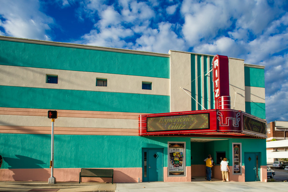 HISTORIC RITZ THEATRE - The Ritz Theatre was constructed in 1939 as a single-screen movie theater. Today, it offers affordable and quality entertainment on a regular basis, from film showings to theater, to live music. The Ritz installed a neon-lit marquee in 2016 and a state-of-the-art sound system in 2017.VISIT WEBSITE →