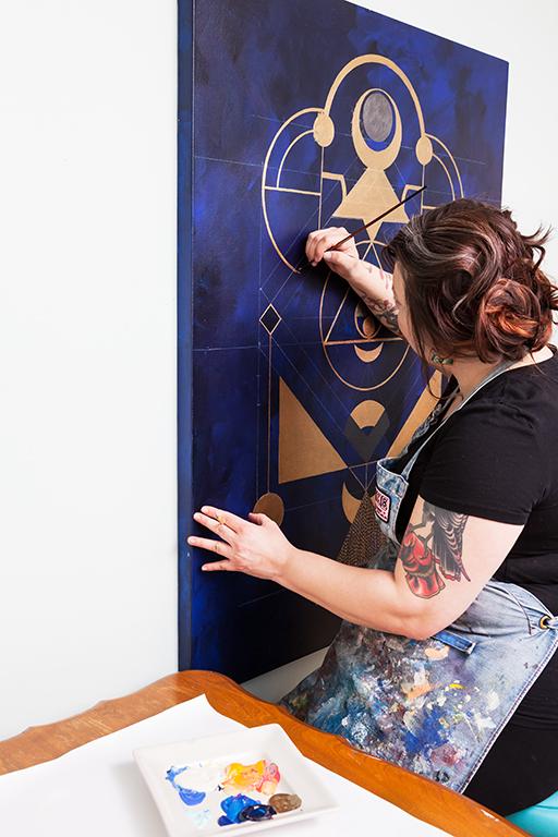 Principal, Niki, working on an original piece