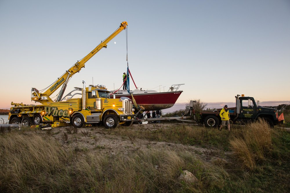 The moon rises as the crew puts final touches on the last boat to be pulled out for the day.