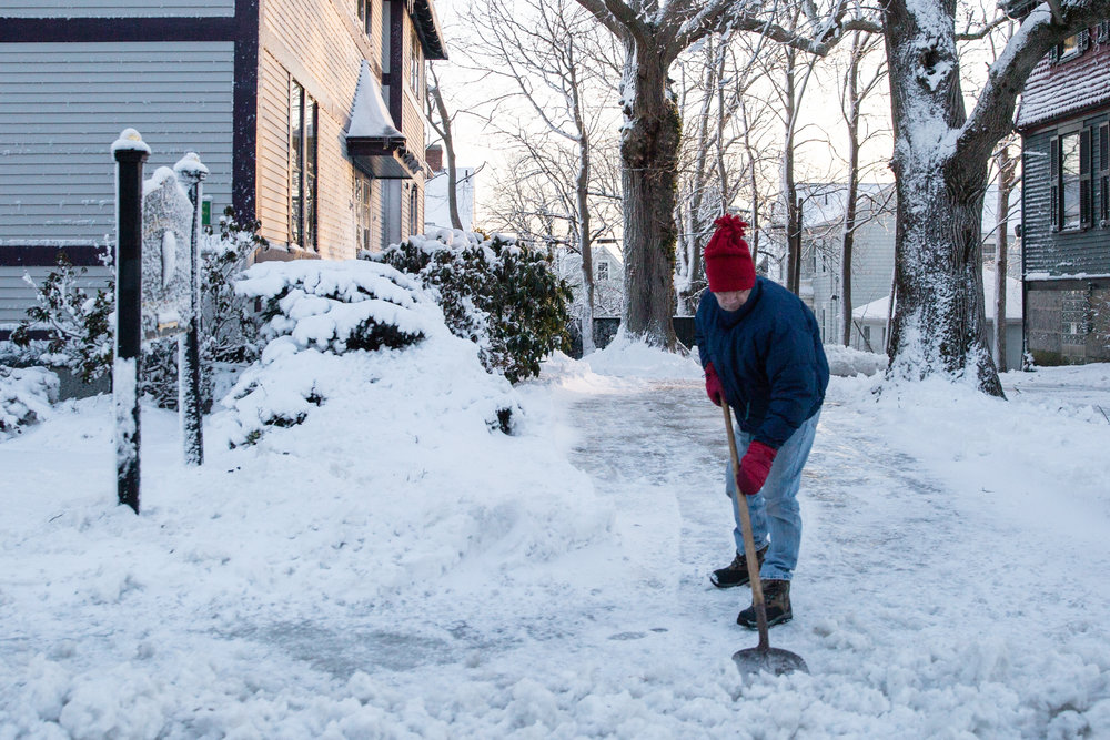 A man shovels snow after the storm. - Dartmouth, MA