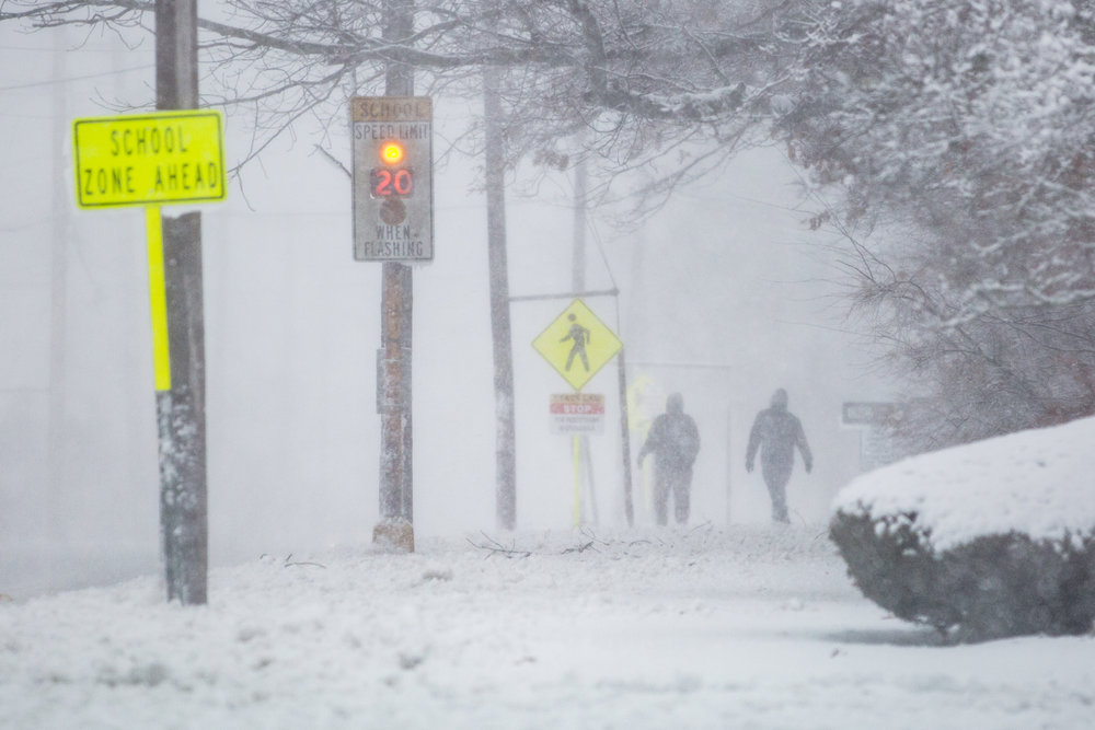 Two brave souls walk along Dartmouth Street during the blizzard. - South Dartmouth, MA
