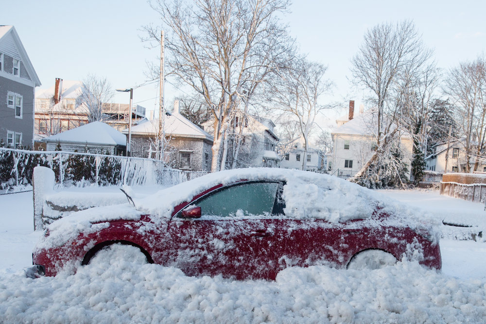 Cars that were left on the street during the parking ban either got towed or plowed in. - New Bedford, MA
