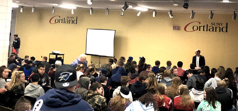 Christopher teaching easy anxiety-reducing meditations to over 100 10th graders at SUNY Cortland during their career day