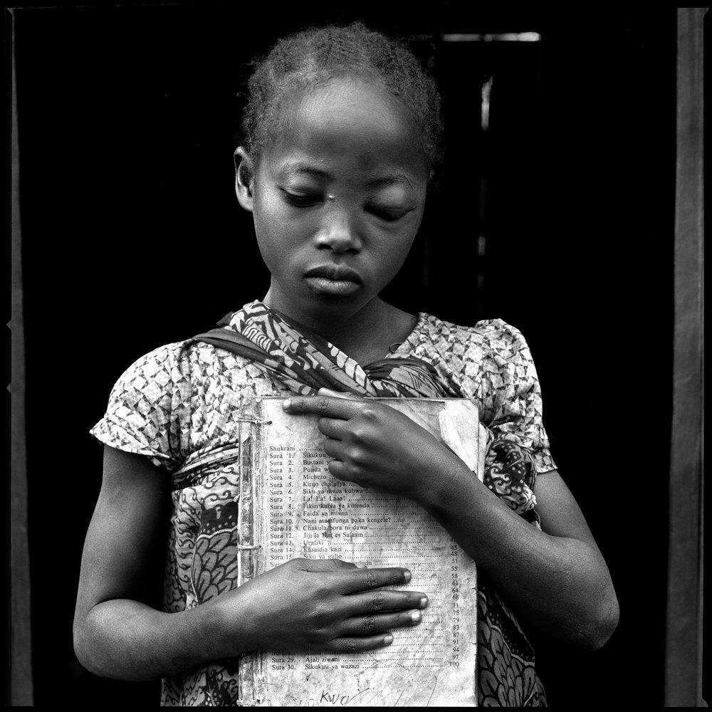 girl-with-schoolbook-tanzania-2006-photo-morten-krogvold_small.jpg