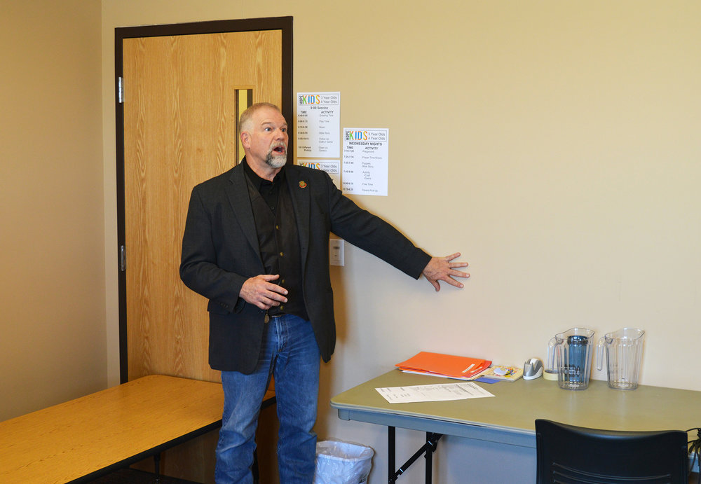 Strategos instructor Burt Whaley explains how to secure a church children's classroom door.