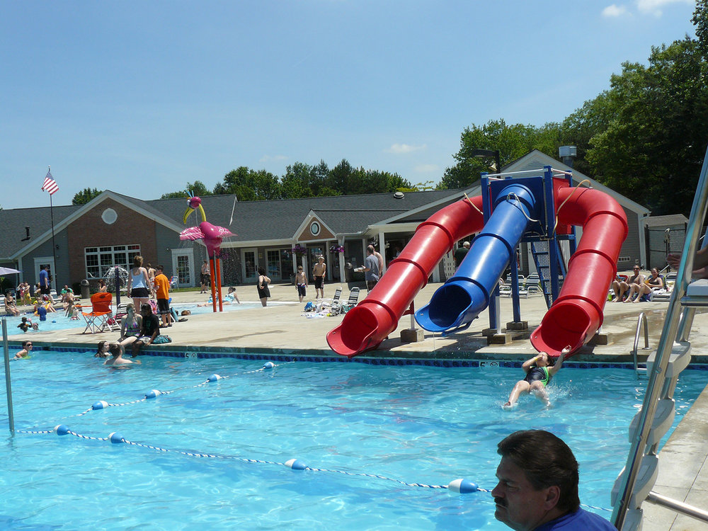 A three-flume waterslide is located on pool deck. Kids, and not-so-young kids, love this feature.